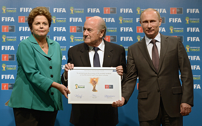 From right: Russian President Vladimir Putin, FIFA president Joseph Blatter and Brazilian President Dilma Rousseff during the official ceremony of handing over the 2018 World Cup signed certificate to Russia, July 13, 2014. (RIA Novosti / Aleksey Nikolskyi)