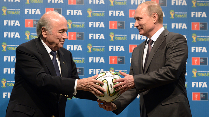 Russian President Vladimir Putin, right, and FIFA president Joseph Blatter during the official ceremony of handing over the 2018 World Cup signed certificate to Russia, July 13, 2014. (RIA Novosti / Aleksey Nikolskyi)