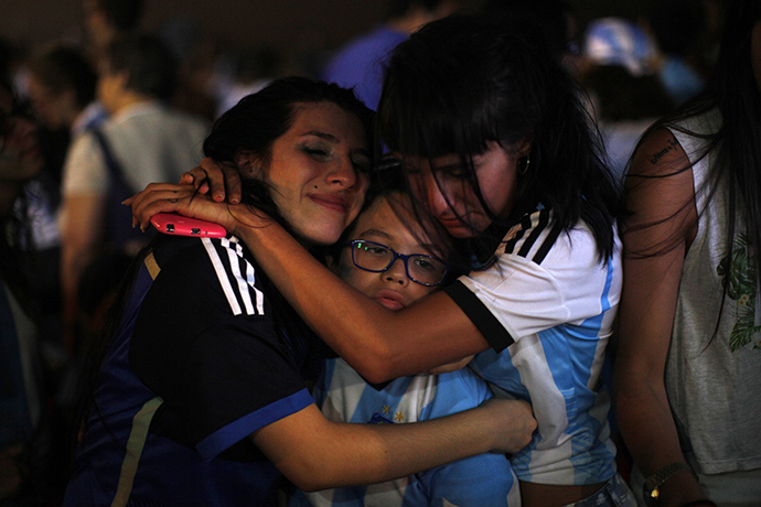 Argentina supporters react after Argentina lost to Germany in their 2014 World Cup final soccer match in Brazil, during a screening at a beach in Rincon de la Victoria, near Malaga, late July 13, 2014. (Reuters / Jon Nazca)