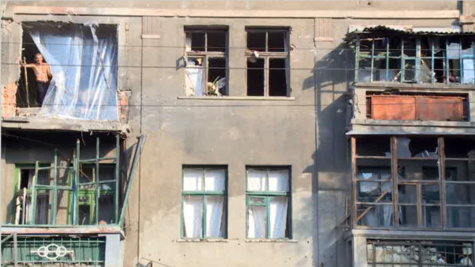 Screenshot from RT video / House damaged by shelling in Lugansk, Eastern Ukraine