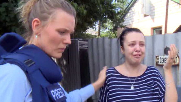 Screenshot from RT video / RT's Maria Finoshina talks to a girl whose mother was wounded in shelling by Kiev's troops in Lugansk, Eastern Ukraine