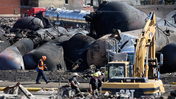Emergency workers work on the site of the train wreck in Lac-Megantic, July 12, 2013. (Reuters / Mathieu Belanger)