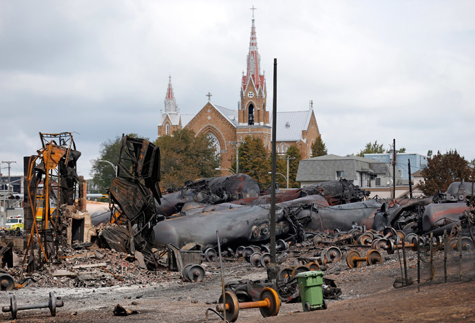 Wagons of the train wreck are seen in Lac Megantic, July 9, 2013. (Reuters / Mathieu Belanger)