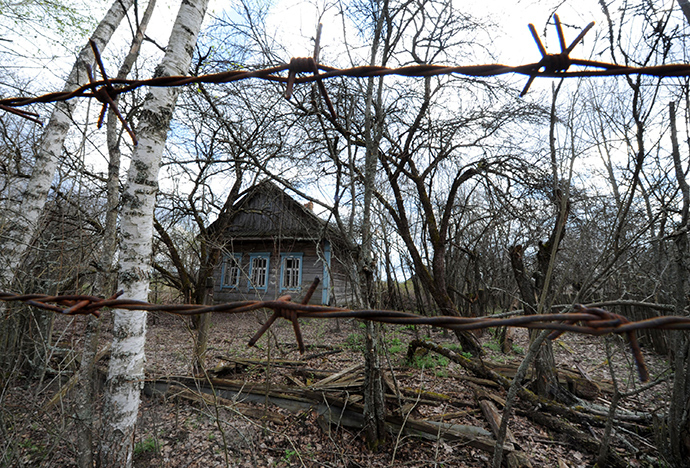 A picture taken through a barbed wire shows the abandoned village of Vezhishche in the 30 km exclusion zone around the Chernobyl nuclear reactor, some 380 km southeast of the Belarus capital Minsk (AFP Photo / Viktor Drachev)