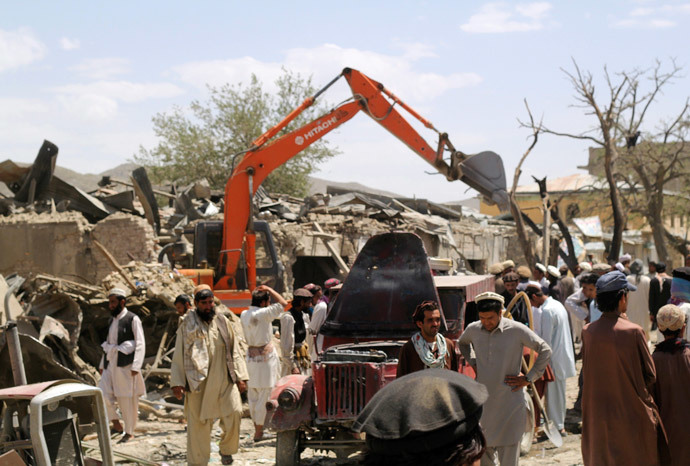 Villagers gather at the site of a car bomb attack in Urgon district eastern province of Paktika July 15, 2014. (Reuters / Stringer)