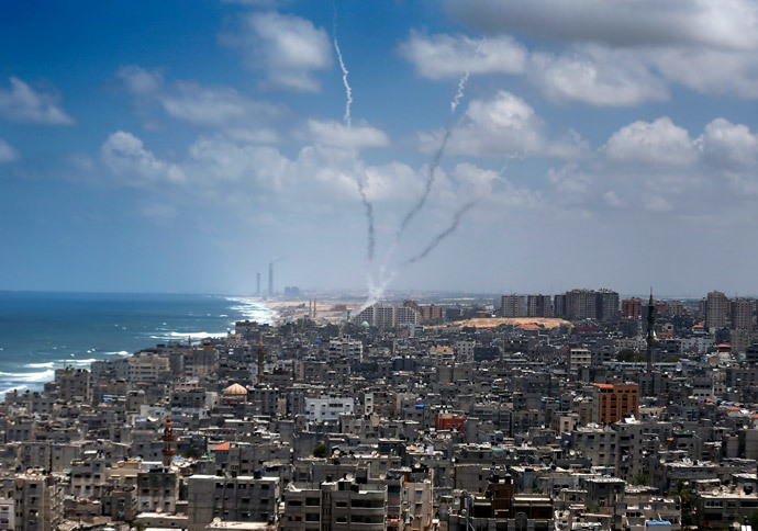 Smoke from rockets fired from Gaza City are seen after being launched toward Israel, on July 15, 2014. (AFP Photo / Thomas Coex)