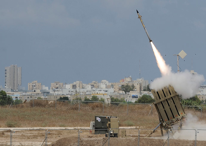 "A missile is launched by an ""Iron Dome"" battery, a short-range missile defence system designed to intercept and destroy incoming short-range rockets and artillery shells, on July 15, 2014 in the southern Israeli city of Ashdod. (AFP Photo / David Buimovitch)"