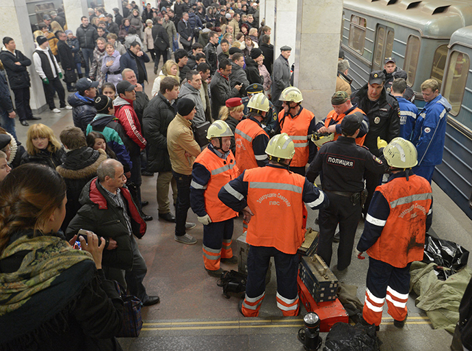 A rescue team on the platform of the Kuzminki metro station where a man fell on train tracks (Reuters / Evgeny Biyatov)