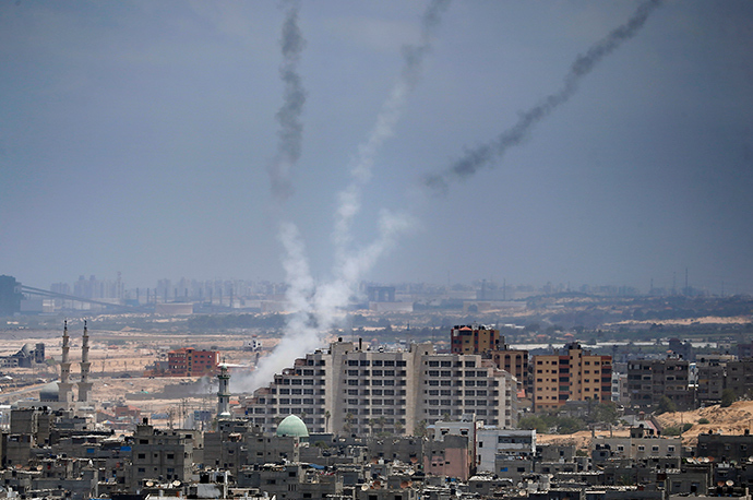Smoke from rockets fired from Gaza City are seen after being launched toward Israel, on July 15, 2014 (AFP Photo / Thomas Coex)