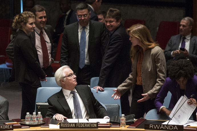 Samantha Power (R), the American ambassador to the United Nations talks to Russia's ambassador to the United Nations, Vitaly Churkin, before a vote regarding the Ukrainian crisis is taken at the U.N. Security Council in New York March 15, 2014. (Reuters/Andrew Kelly)