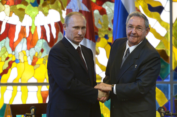 Russian President Vladimir Putin, left, and President of the Council of State and Ministers of the Republic of Cuba Raul Castro Ruz during a press statement at the Palace of the Revolution in Havana. (RIA Novosti/Aleksey Nikolsky)