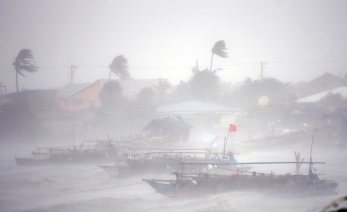 ishing boats are pictured amid heavy winds and rain brought by Typhoon Rammasun (locally named Glenda) as it hit the town of Imus, Cavite southwest of Manila, July 16, 2014. (Reuters)