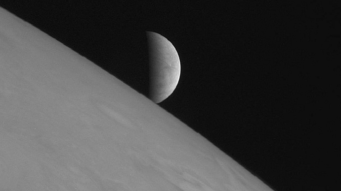 New Horizons took this image of the icy moon Europa rising above Jupiter's cloud tops after the spacecraft's closest approach to Jupiter (Image by Reuters/NASA)