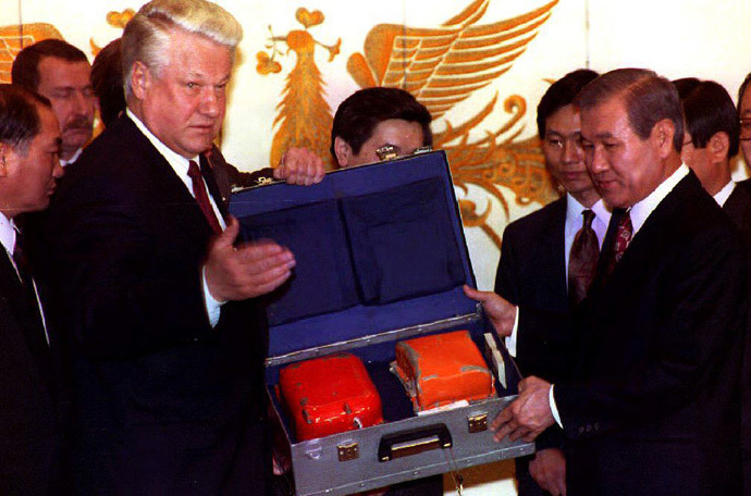 "Boris Yeltsin (L) hands over the ""black box,"" or flight data recorder from Korean Air flight 007 that was downed by Soviet fighters in 1983 to Korean President Roh Tae-Woo at the presidential Blue House 19 November, 1992.(AFP Photo / Choo Youn-Kong)"