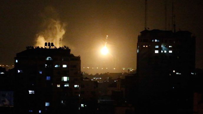 An Israeli missile hits Palestinian buildings in Gaza City on July 17, 2014.(AFP Photo / Thomas Coex )