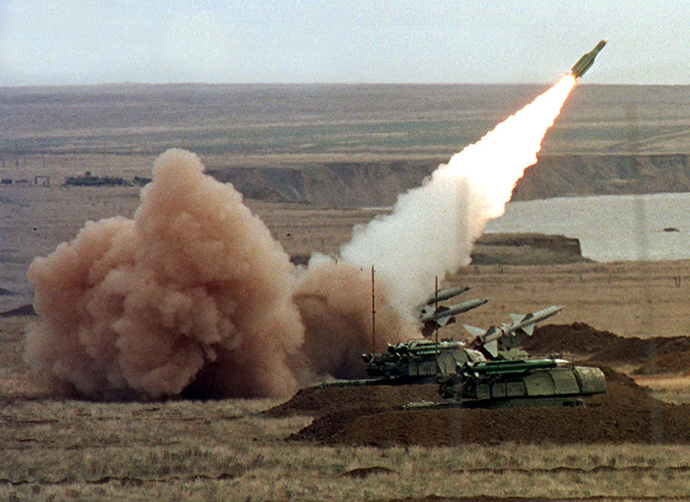 "(File photo) A ""Buk"" anti-aircraft battery launches a ground-to-air missile (Reuters)"