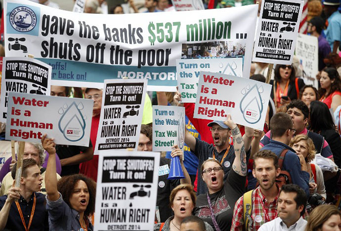 Demonstrators protest against the Detroit Water and Sewer Department July 18, 2014 in Detroit, Michigan. The Detroit Water and Sewer Department have disconnected water to thousands of Detroit residents who are delinquent with their bills. (AFP Photo / Getty Images / Joshua Lott)