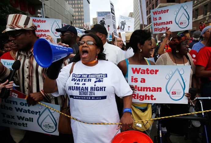 People gather to protest against the mass water shut-offs to Detroit citizens behind in their payments during a demonstration in downtown Detroit, Michigan July 18, 2014. (Reuters / Rebecca Cook)