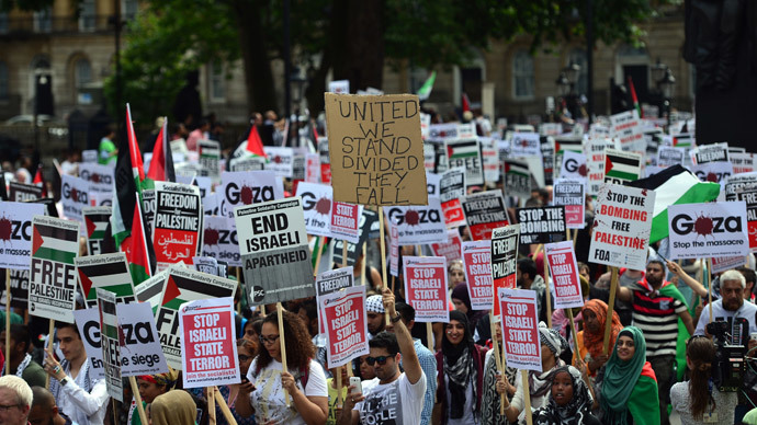 Protesters display placards and banners as they take part in demonstration against Israeli airstrikes in Gaza in central London on July 19, 2014.(AFP Photo / Carl Court)