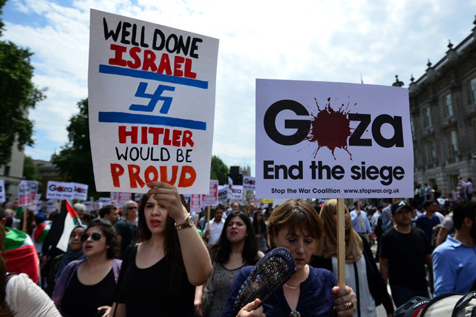 Protesters display placards and banners as they take part in demonstration against Israeli airstrikes in Gaza in central London on July 19, 2014 against Gaza strikes.(AFP Photo / Carl Court)