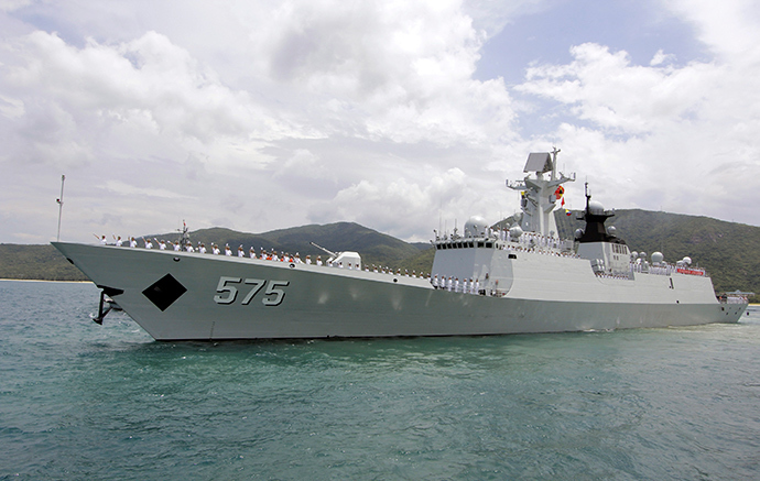 Chinese navy sailors wave as Chinese naval missile frigate Yueyang departs for the Rim of the Pacific exercise (RIMPAC), at a military port in Sanya, Hainan province June 9, 2014 (Reuters / Stringer)