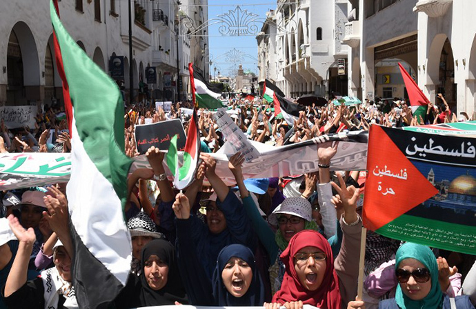 Moroccan protesters shout slogans during a demonstration in support of the Palestinian people and against the ongoing Israeli military offensive in the Gaza Strip, on July 20, 2014, in the capital Rabat. (AFP Photo / Fadel Senna)