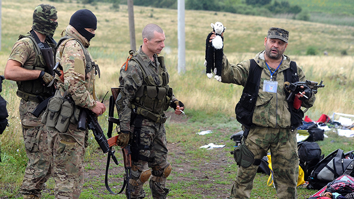 Perverted truth: How rebel mourning MH17 victims was turned into looter with trophy