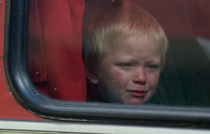 A boy in the bus with Donetsk Region refugees. (RIA Novosti / Mikhail Voskresenskiy)