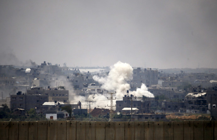 Smoke is seen after an Israeli strike over the Gaza Strip July 22, 2014. (Reuters/Baz Ratner)