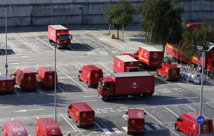 Postal vans wait to be taken out on collection rounds at Mount Pleasant sorting office in London (Reuters/Olivia Harris)