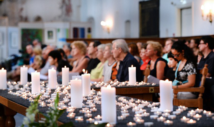 People attend a service in memory of the 298 victims of the downed Malaysia Airlines flight MH17 on July 23, 2014 at the Joriskerk church in Amersfoort. (AFP Photo / Piroschka van de Wouw)