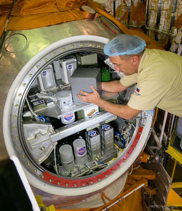 Containers with biological experiment equipment being loaded into the Foton-M satellite. Photo by the Institute for Biomedical Problems (Image from imbp.ru)
