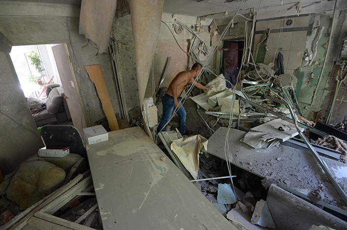 A dweller of an apartment building damaged during an artillery attack by the Ukrainian Security Forces in Donetsk suburb, inside his destroyed apartment. (RIA Novosti / Mikhail Voskresenskiy)