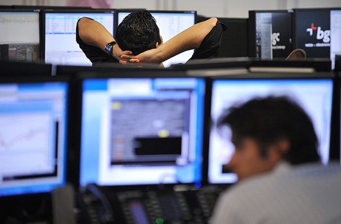 Brokers monitor market movements at the BGC Partners firm in London. (AFP Photo / Ben Stansall)