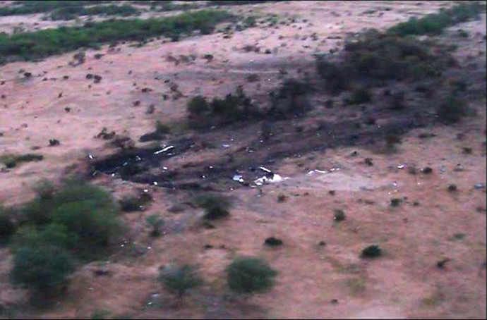 A handout photo released on July 25, 2014 by ECPAD shows the wreckage and debris of the Air Algerie flight AH5017 which crashed in Mali's Gossi region, west of Gao. (AFP Photo)