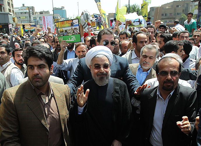 A handout picture released by the official website of the Iranian President Hassan Rouhani shows him attending Quds (Jerusalem) Day demonstration in Tehran on July 25, 2014. (AFP Photo)