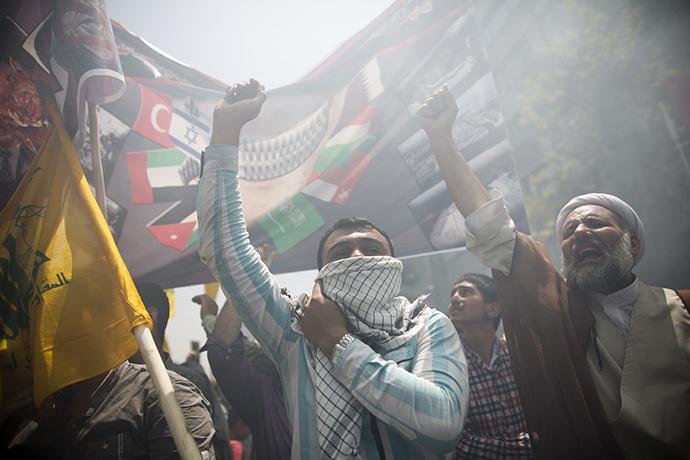 Iranians chant anti-Israeli slogans during a demonstration in Tehran on July 25, 2014 to mark Quds (Jerusalem) Day. (AFP Photo / Behrouz Mehri)