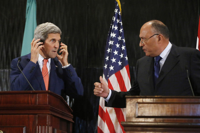 U.S. Secretary of State John Kerry (L) looks at Egypt's Foreign Minister Sameh Shukri during a news conference at a hotel in Cairo July 25, 2014. (Reuters)