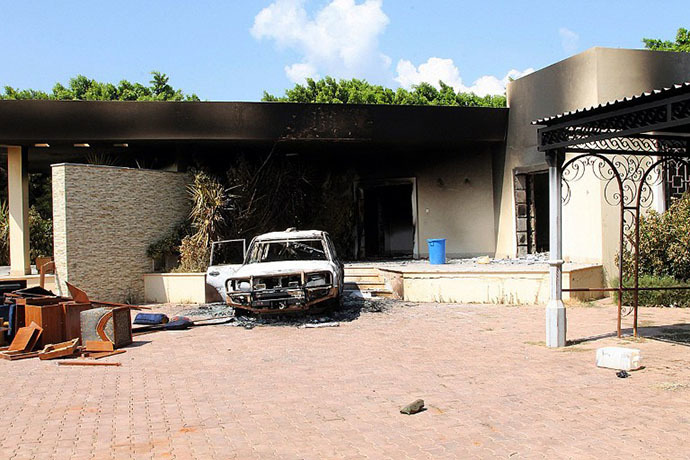 FILE photo. A burnt house and a car are seen inside the US Embassy compound on September 12, 2012 in Benghazi, Libya. (AFP Photo)