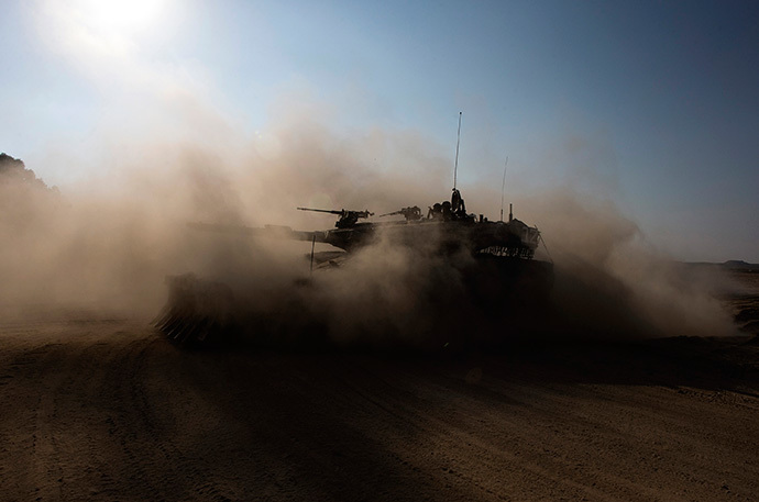 An Israeli army tank moves near the border with the Gaza Strip July 27, 2014. (Reuters / Ronen Zvulun)