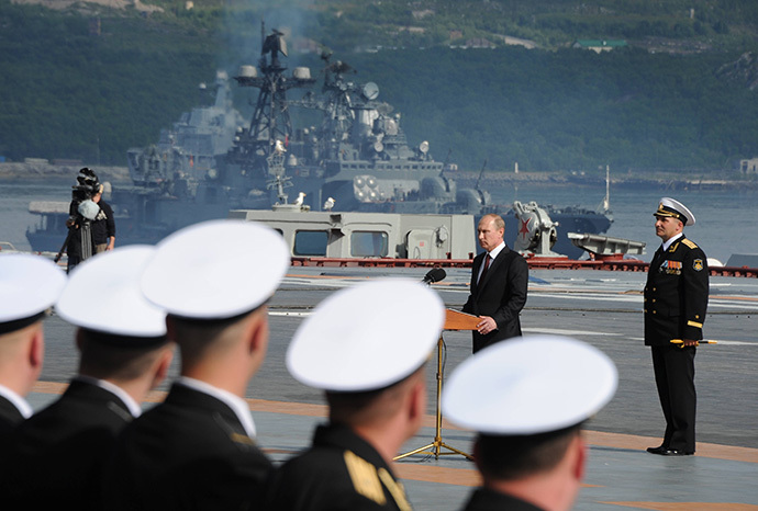 Russian President Vladimir Putin, 2nd right, is seen on board the Admiral Kuznetsov aircraft carrier congratulating mariners before the parade and the staged performance by combat ships of Russia's Northern Fleet, July 27, 2014. (RIA Novosti / Michael Klimentyev)