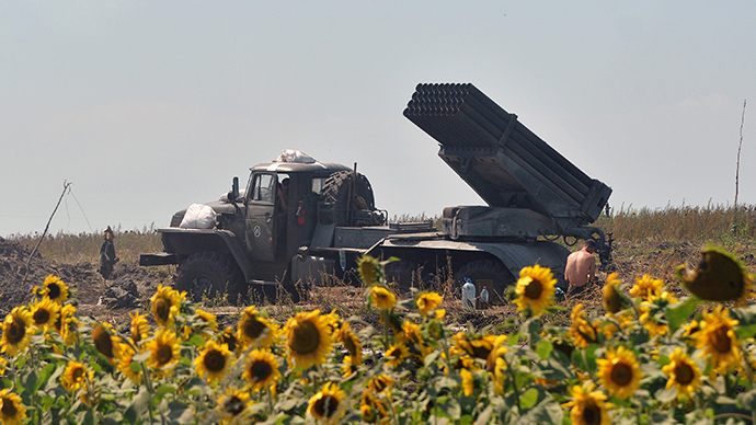 "A Ukrainian serviceman rests near a multiple rocket launcher ""Grad"" set on the position near the eastern city of Seversk on July 12, 2014 (AFP Photo / Genya Savilov)"