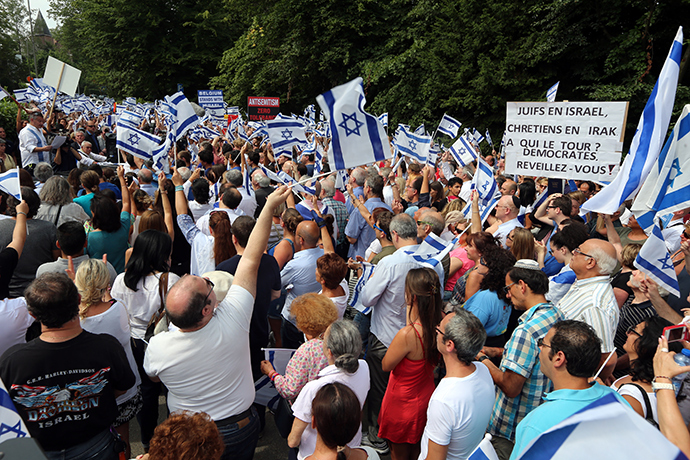 "People wave Israeli flags during a demonstration entitled ""Belgium stands with Israel"" on the Israeli-Palestinian conflict in the Gaza Strip near the Israeli embassy in Brussels on July 27, 2014 (AFP Photo / Nicolas Maeterlinck)"