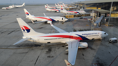 Struggling Malaysia Airlines cuts 6,000 jobs to stay afloat