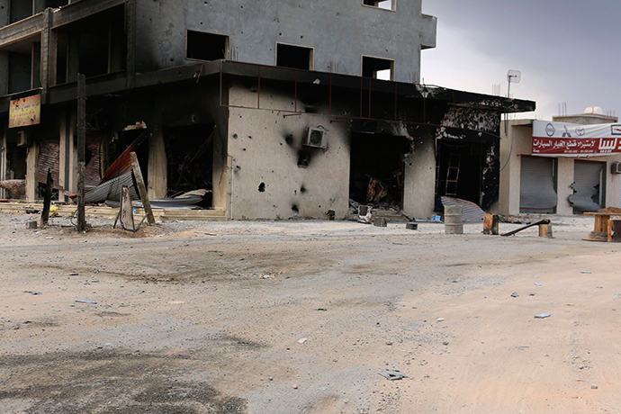 A damaged building is pictured after clashes between rival militias, in an area at Alswani road in Tripoli July 28, 2014 (Reuters / Hani Amara)