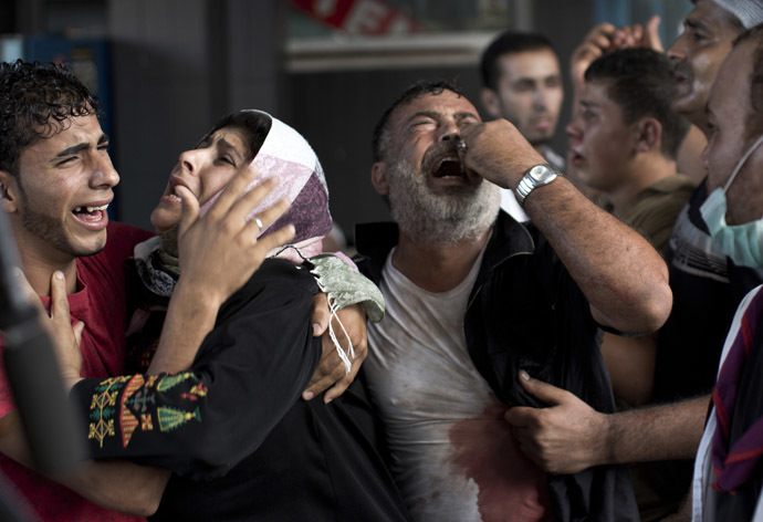 Palestinian mourners cry at Gaza City's al-Shifa hospital after an explosion killed at least seven children in a public playground in the beachfront Shati refugee camp on July 28, 2014. (AFP Photo/Mahmud Hams)