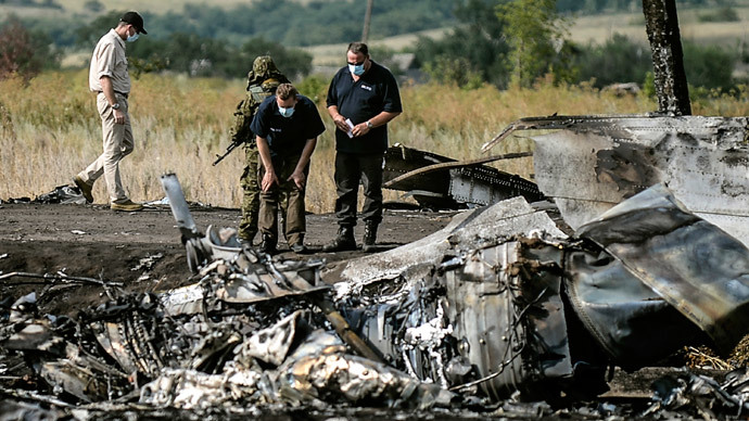 Dutch PM tells Ukraine to stop fighting near MH17 crash site