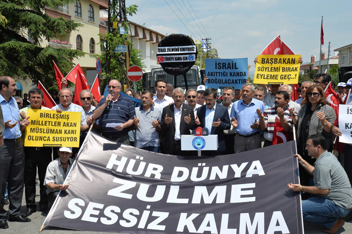 "People take part in a demonstration outside the Israeli Embassy in the Turkish capital Ankara, on July 19, 2014, to protest against Israel's military campaign in Gaza and show their support to the Palestinian people. Banner reads : ""The Free world remains silent to the cruelty"". (AFP Photo / Adem Altan)"