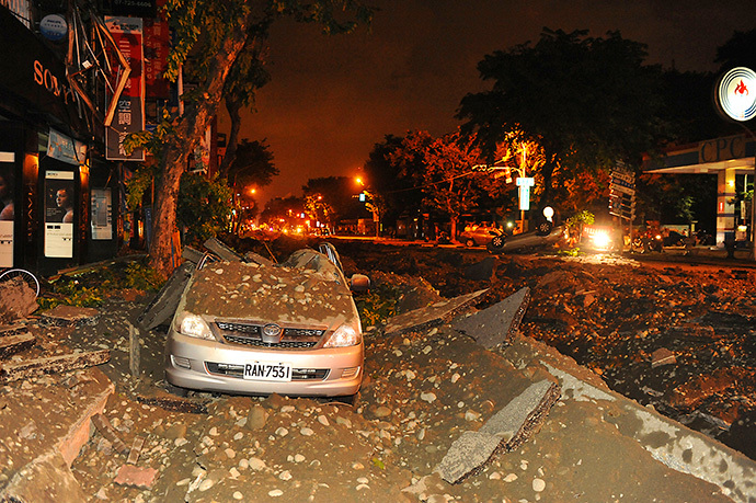 Wreckage of a damaged car is pictured after an explosion in Kaohsiung, southern Taiwan, August 1, 2014. (Reuters / Stringer)