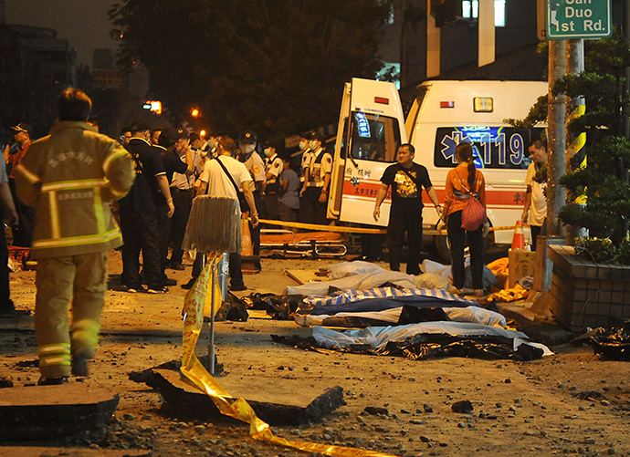 Bodies are seen covered after an explosion in Kaohsiung, southern Taiwan, August 1, 2014. (Reuters / Stringer)